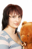 Woman. The young woman with a soft toy stock image