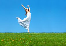 Woman. Happy young woman running  in the field Stock Photo