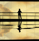 Woman. In the modern buildind at sunset Stock Photos
