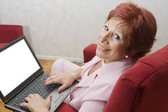 Woman 65 years old with laptop stock photo