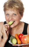 Woman (67 years old) eating vegetables Royalty Free Stock Image