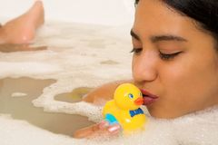 Woman #69. Nude woman in a bath, kissing a plastic duck Royalty Free Stock Photos