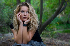 Woman. Portrait of young blond woman sit on a forest stock photography