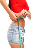 Woman. Young sexy woman measuring her waist. Isolated over white background Stock Image