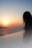 Woman. Enjoying a beautiful sunset at Santorini island, Greece Royalty Free Stock Photo