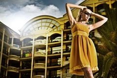 Woman. Young attractive woman over hotel in the evening royalty free stock photo