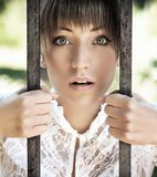 Woman. Surprised young women holding a crate stock photography