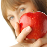 Woman. Young woman with enigmatic glance holding red apple Royalty Free Stock Photos