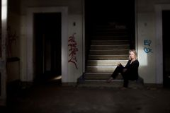 Woman in abandoned building Royalty Free Stock Photo