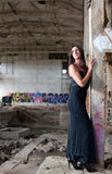Woman in an abandoned factory Stock Image