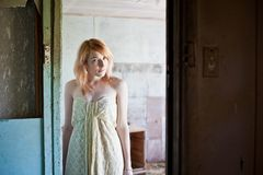 Woman in abandoned house Royalty Free Stock Photography
