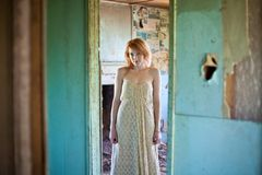 Woman in abandoned house Royalty Free Stock Images