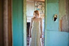 Woman in abandoned house Royalty Free Stock Photo