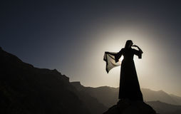 Woman in abaya. A woman in traditional Emirati dress (abaya) in mountains Royalty Free Stock Image