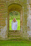 Woman in the Abbey Royalty Free Stock Images