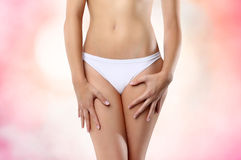 Woman abdomen on pink background Royalty Free Stock Image