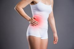 Woman with abdominal pain Stock Images