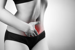 Woman with abdominal pain. Pain in the human body Stock Images