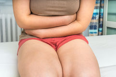Woman with abdominal pain, stomach or menstrual cramps Stock Photo