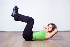 Woman while abdominal training at home Royalty Free Stock Photo