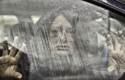 Woman abducted by car. Woman abducted in car and mistreated, violence and crime Stock Photo