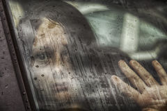 Woman abducted by car. Woman abducted in car and mistreated, violence and crime Royalty Free Stock Photo