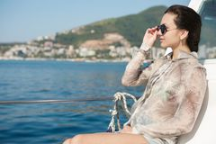 Woman aboard a boat looking at the sea Royalty Free Stock Images