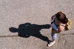 Woman from above_2. Woman from above photographs. Focus on shade Royalty Free Stock Photo