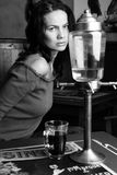 Woman at absinthe bar Stock Images