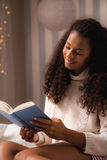 Woman absorbed with a new book Royalty Free Stock Images
