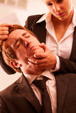 Woman abusing a man in the workplace Royalty Free Stock Image