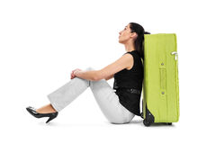 Woman abuts her back in a suitcase. Stock Photos