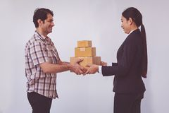 Woman accepting receive a delivery of boxes from delivery asian man stock images