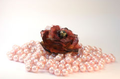 Woman accesoryis and jewelrys. Brown material flower with pink pearls Royalty Free Stock Image