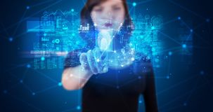 Woman accessing hologram with fingerprint. Woman accessing modern hologram personal database with fingerprint identification stock photography