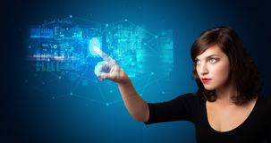 Woman accessing hologram with fingerprint. Woman accessing modern hologram personal database with fingerprint identification royalty free stock images