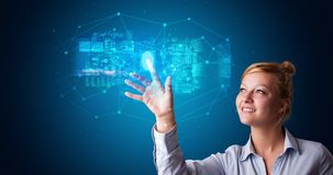 Woman accessing hologram with fingerprint. Woman accessing modern hologram personal database with fingerprint identification royalty free stock photography