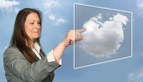 Woman Accessing Virtual Cloud. Woman Touching Virtual Cloud Grid With Her Finger Royalty Free Stock Photography