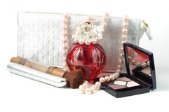 Woman accessoreis. Cosmetick, perfume and pearl necklace on white Stock Photography