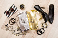 Woman accessories arranged on the floor. Stock Photo
