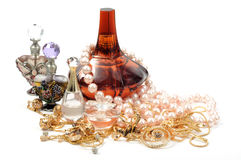 Woman accessory. Luxury perfumes and gold jewelry with pearl necklace Royalty Free Stock Image