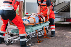 Woman after accident on the stretcher Royalty Free Stock Photos