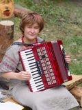 Woman with an accordion Royalty Free Stock Photo