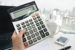 Woman accountant with calculator Stock Image