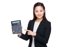 Woman accountant with finger point to calculator Royalty Free Stock Image