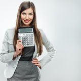 Woman accountant show calculator. Young business woman. Royalty Free Stock Photo