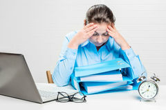 Woman accountant works with documents. Her head is very sore Royalty Free Stock Photography