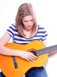 Woman with acoustic guitar Royalty Free Stock Photos