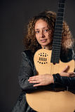 Woman with acoustic guitar Royalty Free Stock Image