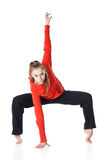 Woman is an acrobat. On white background Royalty Free Stock Photo